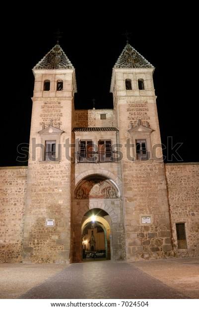 Puerta de Bisagra or Alfonso VI Gate illuminated at night, Toledo, Spain.