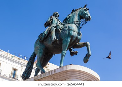 Puerta del Sol with the monument to King Charles III in Madrid, Spain