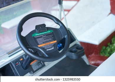 PUERTO AVENTURAS, MEXICO 28 FEBRAURY 2019: Steering wheel and dashboard of a club car, used for moving objects inside a resort in Mexico
