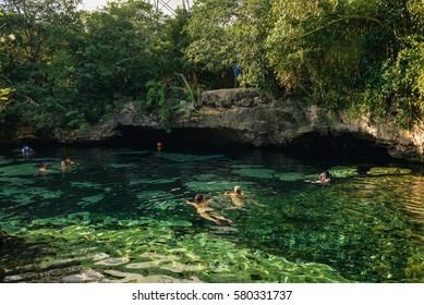 Puerto Aventuras, Quintana Roo/Mexico- November 27, 2016: People swim in the Azul cenote