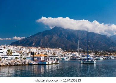 PUERTO BANUS MARBELLA, SPAIN - MAY 2018: view of the pier of Puerto Banus with luxurious boats and white houses in the city of Marbella in the morning. Andalusia, Spain