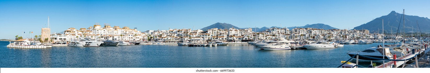 PUERTO BANUS, SPAIN 02 JULY 2017: Ultra High Definition Panorama of Puerto Banus, Marbella, Spain showing luxury yachts and motor cruisers of the rich and famous moored in the Port