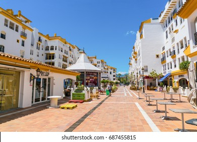 Puerto Banus, Spain, June 28 2017: quiet street at the harbour of Puerto Banus