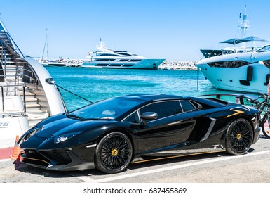 Puerto Banus, Spain, June 28 2017: rblack Lamborghini in the harbour