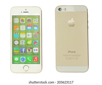 PUERTO CRUZ, SPAIN - JULY 06, 2014.  New Apple  Iphone 5s in gold color on white. The iPhone is the top-selling phone of any kind in some countries including, the United States and Japan