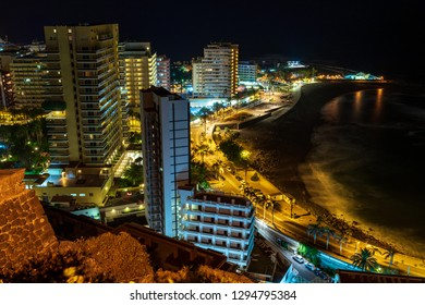 PUERTO DE LA CRUZ, CANARY ISLANDS, SPAIN - JULY 30, 2018: A view of the night city from a height. Viewpoint: Mirador La Paz.