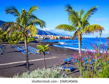 Puerto de la Cruz, Tenerife, Canary Islands, Spain: Famous beach Playa Jardin with black sand in a beautiful day