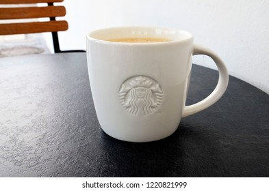 Puerto de la Cruz,Tenerife - September 09,2018:White coffee cup on the table in a Starbucks store.Starbucks Corporation is an American coffee company and the largest coffeehouse company in the world.