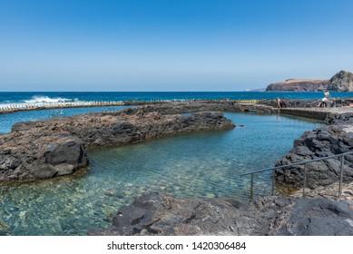 PUERTO DE LAS NIEVES, GRAN CANARIA, SPAIN - MARCH 11, 2019: Natural pool Las Salinas de Agaete in Puerto de Las Nieves. Copy space for text