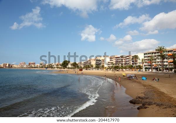 PUERTO DE MAZARRON, SPAIN - JUNE 16: Beautiful beach in Mediterranean town Puerto de Mazarron. June 16, 2014 in Puerto de Mazarron, Province of Murcia, Spain