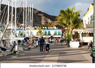 Puerto de Mogan, Gran Canaria, Spain - 06 January 2018. Promenade in  Puerto De Mogan in very popular holiday village Puerto Mogan, Gran Canaria, Spain