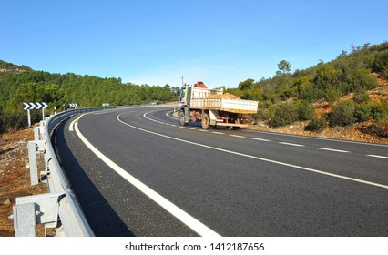 Puerto de Niefla, Spain - Jan 3, 2011: Road maintenance truck in mountain pass. Valley of Alcudia and Sierra Madrona Natural Park, province of Ciudad Real, Spain.