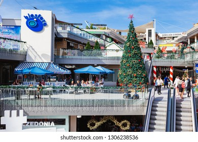 PUERTO DEL CARMEN, LANZAROTE - 23 December 2018. Shops and people in Biosfera shopping centre in Puerto del Carmen in Lanzarote, Canary islands, Spain, selective focus