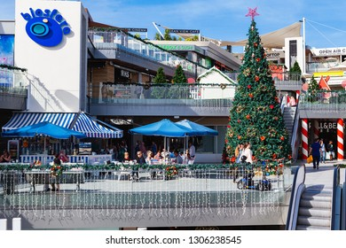 PUERTO DEL CARMEN, LANZAROTE - 23 December 2018. Shops and people in Biosfera shopping centre in Puerto del Carmen in Lanzarote, Canary islands, Spain