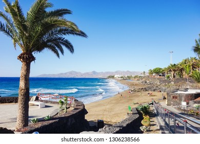 PUERTO DEL CARMEN, LANZAROTE - 23 December 2018. Puerto del Carmen beach in Lanzarote, Canary islands, Spain. blue sea, palm trees, selective focus