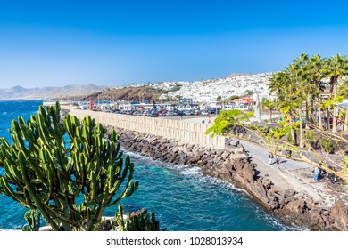 Puerto del Carmen, Spain - December 27, 2016: day view of old town and port boardwalk in Puerto del Carmen, Spain. Puerto del Carmen is the main tourist town on the island of Lanzarote, Canary Islands