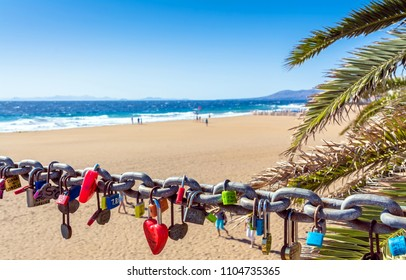 Puerto del Carmen, Spain - December 29, 2016: love locks, beach and ocean in Puerto del Carmen boardwalk, Spain. Puerto del Carmen is the main tourist town on the island of Lanzarote