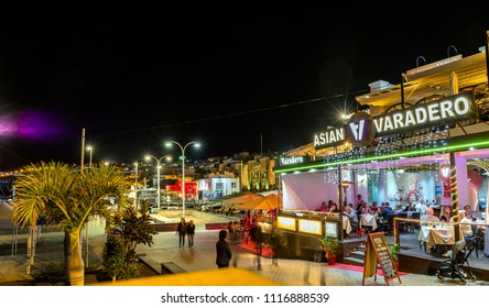 Puerto del Carmen, Spain - December 29, 2016: night view of old town and port boardwalk with tourists in Puerto del Carmen, Spain. Puerto del Carmen is the main tourist town on the island of Lanzarote