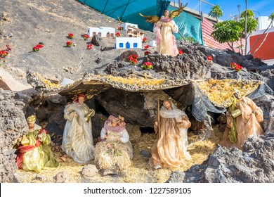 Puerto del Carmen, Spain - December 30, 2016: Christmas Nativity scene showing the cave with the baby Jesus, Mary and Joseph in Lanzarote, Spain.