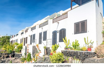 Puerto del Carmen, Spain - December 30, 2016: day view of typical houses in Puerto del Carmen, Spain. Puerto del Carmen is the main tourist town on the island of Lanzarote, Canary Islands.