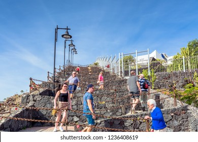 Puerto del Carmen, Spain - December 30, 2016: day view of old town  boardwalk with tourists along stairs in Puerto del Carmen, Spain. Puerto del Carmen is the main tourist town in Lanzarote Island