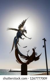 Puerto del Rosario, Spain - December 6, 2018: Cockfighting sculpture at seafront promenade of Puerto del Rosario town, Fuerteventura, Canary Islands