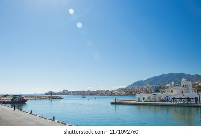 Puerto Deportivo de Benalmádena, Costa del Sol, Malaga, Andalusia, Iberian Peninsula, with mountains in the background during a sunny day.