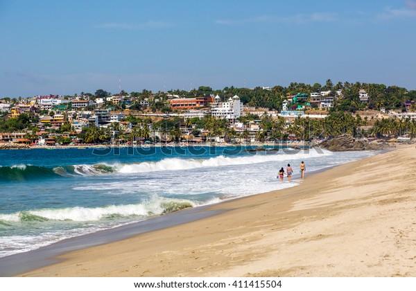 Puerto Escondido, Mexico - Beautiful sunny day in the desert beach of Puerto Escondido in the western coast of Mexico.