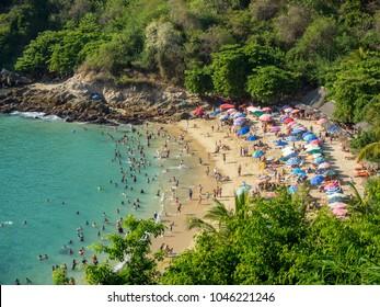 Puerto Escondido, Oaxaca, Mexico, South America - January 2018: [Playa Carrizalillo, crowdwed natural beach, tourist destination]