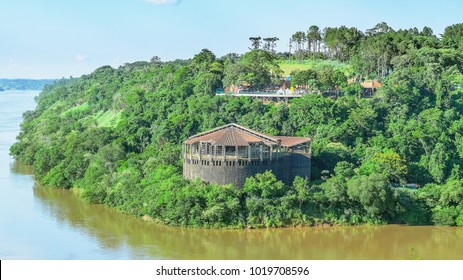 Puerto Iguazu, Argentina - January 07, 2018: Structure across the river surrounded by nature, the Espaco das Americas, an old amphitheater abandoned on Foz do Iguacu, and Marco das Tres Fronteiras.
