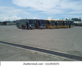 Puerto Limon, Costa Rica - June 12, 2010: Busses lined up waiting outside the port.