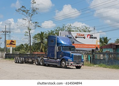 PUERTO LIMON,COSTA RICA-MARCH 20, 2017: Blue truck on Highway 32 at Puerto Limon, Costa Rica