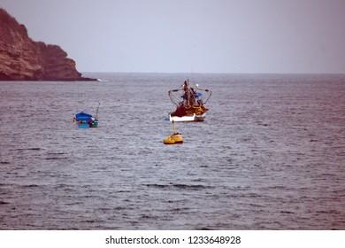 PUERTO LOPEZ, ECUADOR - CIRCA JULY 2018: Shrimping trawlers in the harbor