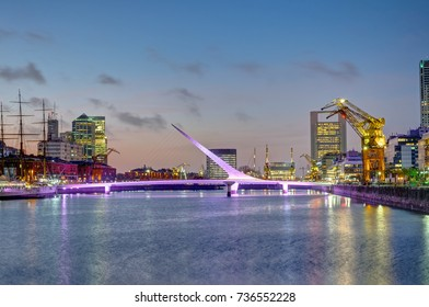 Puerto Madero and the Puente de la mujer in Buenos Aires, Argentina, at sunset