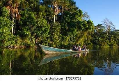 PUERTO MALDONADO, MADRE DE DIOS - PERU, CIRCA 2013: Instant of a boat with people sailing in the river, Circa 2013 in Puerto Maldonado. The rivers are the main roads in the Amazon jungle.