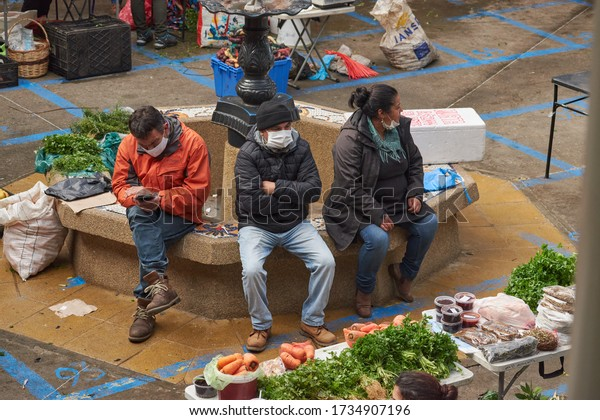 Puerto Montt, Chile May 16, 2020: People wearing surgical mask and buying natural products at Mercado Municipal Presidente Ibañez despite the coronavirus - COVID-19