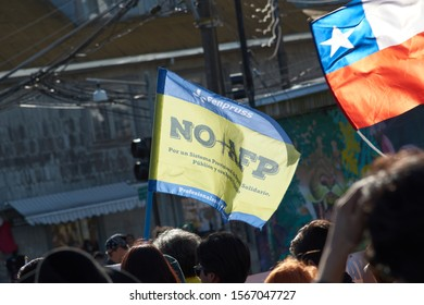 """Puerto Montt / Chile - November 20 2019: """"No More AFP"""". Chilean people in a massive protest at Puerto Montt. Protesters with chilean flag."""