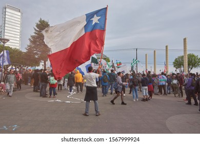 Puerto Montt - Chile; November 22, 2019: People of Puerto Montt continue to express themselves in favor of dignified life and a constituent assembly. Chilean flag.