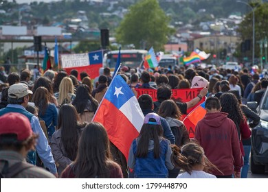 Puerto Montt / Chile - October 23 2019: Chilean people in a massive protest at Puerto Montt. Protesters with chilean flag.