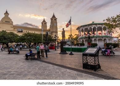 PUERTO PLATA, DOMINICAN REPUBLIC - DECEMBER 12, 2018: Evening at Parque Central square in Puerto Plata, Dominican Republic