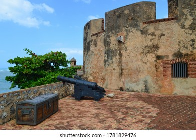 PUERTO PLATA, DOMINICAN REPUBLIC - FEBRUARY 16TH, 2016: Cannon and chest at the Fortress of San Felipe, Puerto Plata