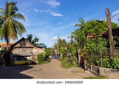 Puerto Princesa, Palawan, Philippines - September 26, 2018: Residential houses on rural street.