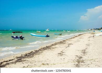 Puerto Progreso seafront. Beach near Merida with fishermen boats. Yucatan, Mexico.