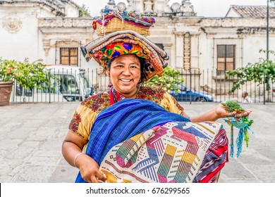 PUERTO QUETZAL, GUATEMALA - June 13, 2017: Indigenous Mayan market women sell handicrafts to international tourists in the streets and parks of Puerto Quetzal, Guatemala.