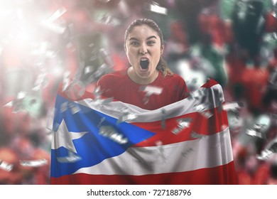 Puerto Rican female fan holding the national flag