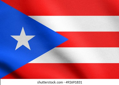 Puerto Rican national official flag. Patriotic symbol, banner, element, background. Flag of Puerto Rico waving in the wind with detailed fabric texture