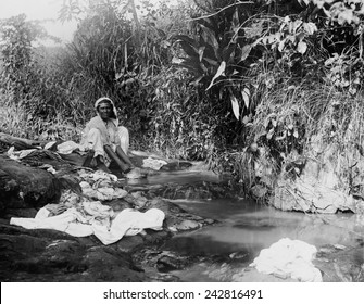 Puerto Ricans women washing laundry in an open stream shortly after Puerto Rico was annexed by the United States after the Spanish American war. Ca. 1903