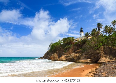 Puerto Rico coastline beach at Punta Tuna lighthouse in summer with a blue sky and clouds