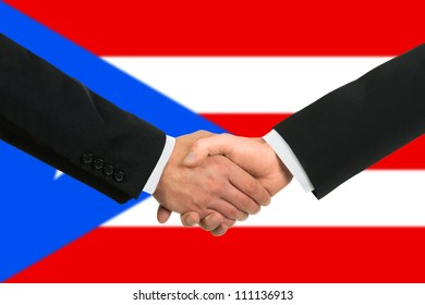 The Puerto Rico flag and business handshake
