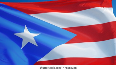 Puerto Rico flag waving against clean blue sky, close up, isolated with clipping path mask alpha channel transparency